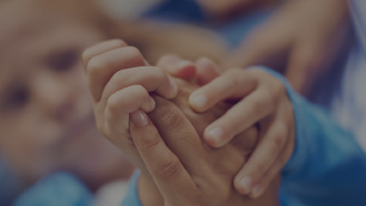 focus on a handshake between a woman and her child