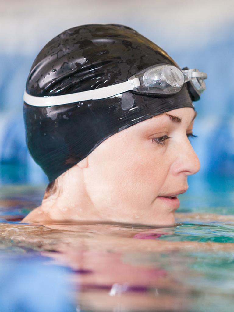 woman swimming with swim cap